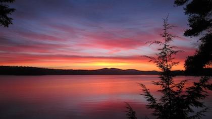 photo of sunrise over lake