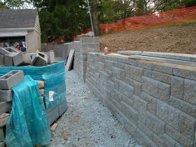 the tall concrete pier halfway down the wall is plumb note how the segmental retaining - Segmental Retaining Wall Design 2