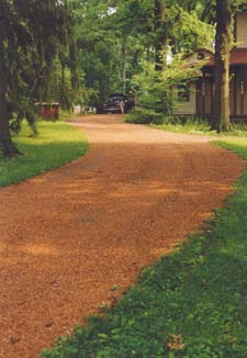 Here is my driveway after it had been in for nine years. It still looks like the day it was installed. When was the last time you saw a brown gravel drive with this amount of character? If you want to see what it looks like today, go read my updated column on tar and chip driveways.