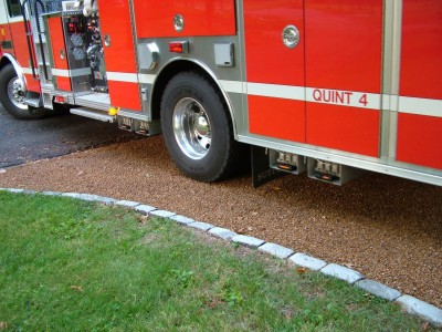 With proper installation, your home tar and chip driveway can stand up to the weight of a fire engine. PHOTO CREDIT: Tim Carter