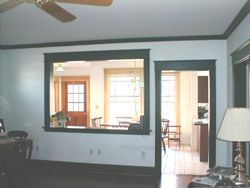 This load bearing wall has a large opening and a doorway. PHOTO CREDIT: Tim Carter