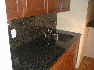 Granite backsplach and counter add a gorgeous touch.