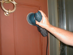 Sanding a painted surface is easy with handy palm or hand-held sander. Photo credit: Tim Carter