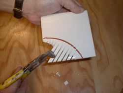 Cutting circles in replacement or new ceramic tile requires the right tools and some skill. Photo credit: Tim Carter