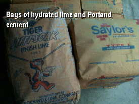 The bags of lime and cement look almost identical but believe me, they are as different as cats and dogs.