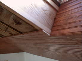 Installing wood on a vaulted ceiling requires special talent, tools and techniques. You will proably discover that some colored wood putty will also come in handy.