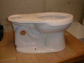 This is a fairly standard toilet bowl. Note the exposed colon of the toilet.  It is the snake-like bulge that leaves from the left-bottom of the bowl and travels up and over the hole.  The end of the colon is right at the base of the toilet foot where you see the small hole for the toilet bolt.
