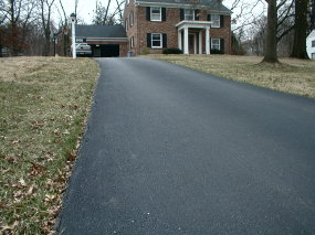 If you want velvet smooth blacktop as on this driveway, then you better have a smooth base that will not heave and move as concrete slabs might.