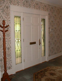 The biggest challenge in replacing this door would be making sure the woodwork surrounding the door is placed back exactly where it is now. The wallpaper will look perfect if this happens.