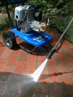 That black goo is just one year's accumulation of maple tree droppings, algae and dirt. I can safely use the pressure washer on my patio because the mortar is about 7,000 psi strength and the brick are special outdoor paving brick that are very hard.