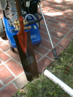 A pressure washer, duckbill shovel and a pipe cut with a chisel point are great tools to quickly create a tunnel under a paved surface.