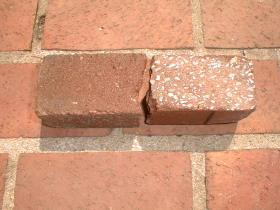 I cracked the new paving brick in half. Look at how light-colored the aggregate is!  Over time when the red cement paste wears off, the pavers will look different. My traditional clay paving brick patio  will stay red forever, because the red clay is the same color throughout the entire brick.