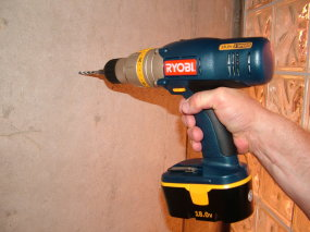 A cordless hammer drill like this one makes easy work of drilling into stucco.