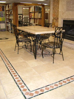 The large tiles on this floor were set on smooth concrete. The smaller inlay tile make for a splendid contrast.