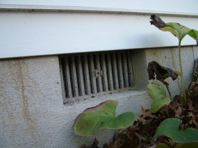 This vent is open now.  But should it be closed in winter and open in summer or closed in summer and open in winter? PHOTO BY: Tim Carter