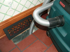 Use a wet-dry vacuum to suck out water from the ducts under a concrete slab. PHOTO BY: Tim Carter