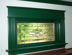 This gorgeous custom-made beveled and stained glass panel is not sandwiched between the insulated glass. It lays on top of the insulated glass and is permanently  held in place with caulk . PHOTO CREDIT: Tim Carter