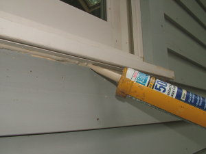 Caulk is a powerful weapon to stop water intrusion that can ruin a new house painting job. PHOTO CREDIT: Kathy Carter