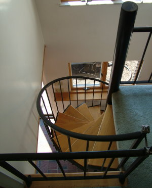 This five-foot wide set of spiral stairs has been heavily used for nearly 20 years. The oak treads are screwed to the metal treads making for a classy, yet contemporary look. PHOTO CREDIT: Tim Carter