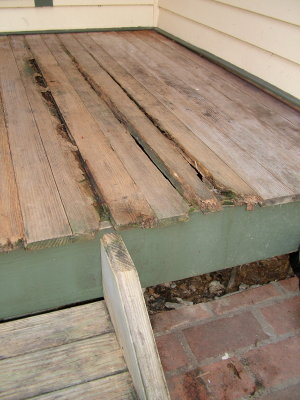 This tongue and groove porch flooring is exposed to the weather. It suffered serious rot because it was not treated with a preservative. PHOTO CREDIT: Tim Carter