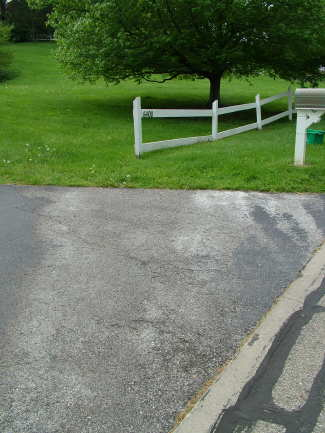 This light-colored area on the driveway was caused by water that flows from an active spring. PHOTO CREDIT: Tim Carter