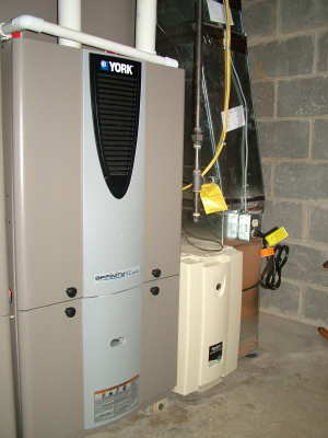 Installing a furnace requires great skill, specialized tools and experience. This ultra-high-efficiency York furnace with a gas modulating valve took Richard Anderson, the BEST HVAC craftsman in greater Cincinnati, OH, several days to install. PHOTO CREDIT: Tim Carter