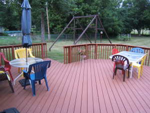 This deck was built by a novice with a little coaching from a pro. The homeowner planned it well as the deck is large enough for two separate seating areas. PHOTO CREDIT: Tim Carter