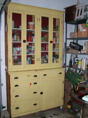 This garage cabinet was salvaged for free from a remodeling job. It is well-built, and the glass doors let you see what is on the shelves. PHOTO CREDIT: Tim Carter