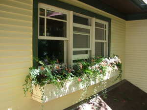 This window box loaded with soil and plants weighs over 200 pounds. It is anchored directly to the wall studs with heavy-duty stainless steel clips and bolts. PHOTO CREDIT: Tim Carter