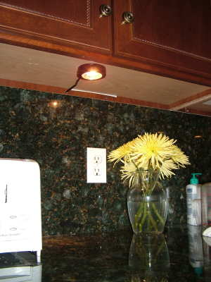 This under cabinet light was installed in less than an hour. It really does a fantastic job of highlighting the granite backsplash and countertop. PHOTO CREDIT: Tim Carter