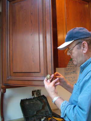 This cabinet knob is being installed by master carpenter Manfred Ellers. You can do it yourself so long as you take your time and use the right tools. PHOTO CREDIT: Tim Carter