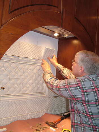 This highly-decorative kitchen tile backsplash was installed in one day. Ceramic tile is relatively easy to install if you have the right tools. PHOTO CREDIT: Kelly Carter