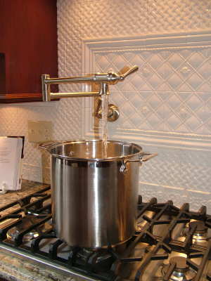 Here is the sweet pot filler in action. The valves do not restrict the flow of water, and large pots fill quickly. PHOTO CREDIT: Tim Carter