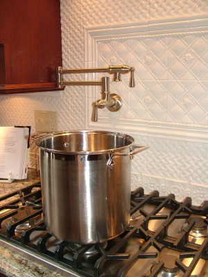 Check out this cool pot filler faucet right at the cooktop. You now only have to carry heavy pots of water one way. This model is from the ShowHouse collection by Moen. PHOTO CREDIT: Tim Carter