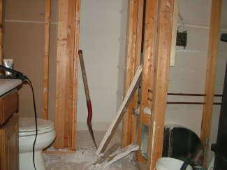 The demolition work in this bathroom can happen in stages to minimize the loss of use of the toilet and sink. PHOTO CREDIT: Tim Carter