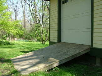 This shed ramp is very close to the maximum slope that allows you to safely drive a riding mower into the shed. PHOTO CREDIT: Brent Walter
