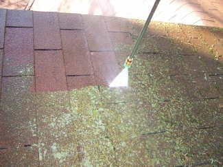 You can use a pressure washer to clean moss, lichens and algae from asphalt shingle roofs. But, you must be careful! PHOTO CREDIT: Brent Walker