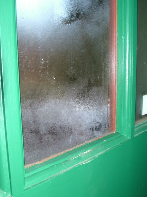 This glass has condensation on it that can peel the paint and cause both wood rot and mold if it is not stopped!  PHOTO CREDIT: Tim Carter