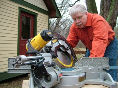You can see the saw blade is angled two directions at once. The shiny pistons are a giveaway that this is a sliding compound miter saw.  PHOTO CREDIT: Brent Walter