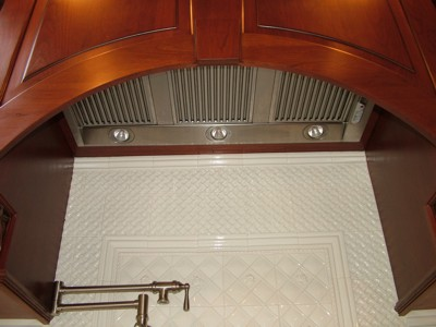 PHOTO CAPTION: This high-powered kitchen exhaust fan is tucked up under a decorative hood. It is sized properly for the large kitchen.  IMAGE CREDIT: Tim Carter