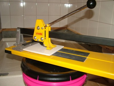 This ceramic-tile cutter can make precision cuts on many types of small and large tile.  PHOTO CREDIT: Tim Carter