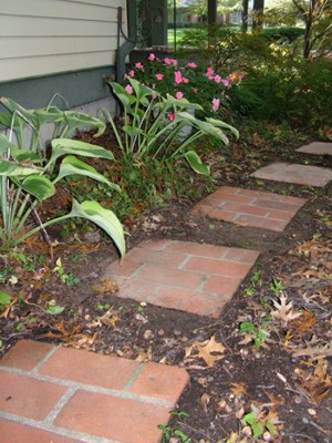 If you want to work with pavers, pick a small project like brick paver stepping stones. PHOTO CREDIT:  Tim Carter