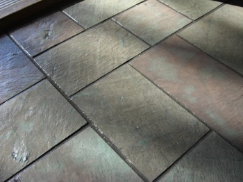 Slate is an attractive and durable flooring material. There are many other uses for it as well around the house. PHOTO CREDIT:  Tim Carter