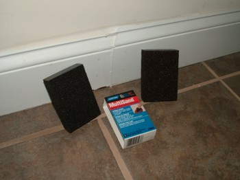 These sanding blocks are the perfect tool to sand the contoured and flat profiles of the baseboard. PHOTO CREDIT: Tim Carter
