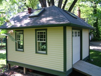 This  Queen Anne Victorian garden storage shed was built to match the owners house. The soffit material is real stained bead board! PHOTO CREDIT:  Tim Carter