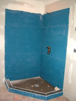 This coated backer board is easy to install and works well on walls and floors. PHOTO CREDIT:  Tim Carter