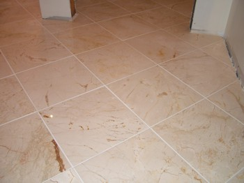This marble tile floor took two days to install, but was well worth the effort. PHOTO CREDIT:  Tim Carter