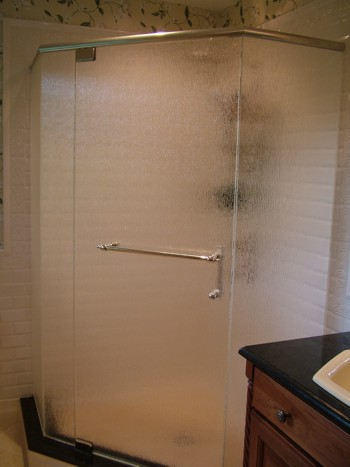 This frameless shower door really adds to the appeal of this custom bathroom. PHOTO CREDIT:  Tim Carter