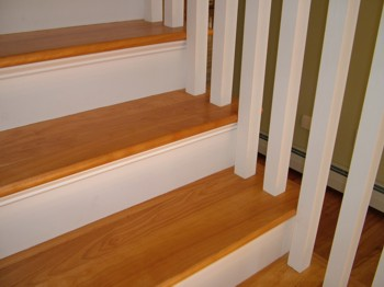 These oak stair treads go well with the white square balusters. PHOTO CREDIT:  Tim Carter