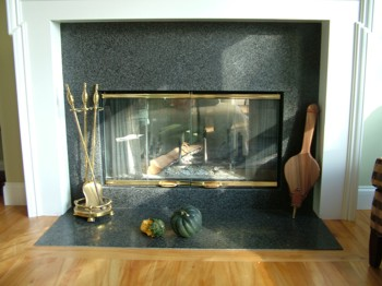 You can really jazz up your fireplace with functional and good-looking accessories. PHOTO CREDIT:  Tim Carter